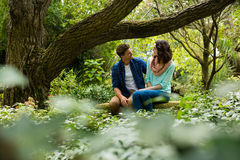 Romantic couple interacting with each other in garden Stock Image