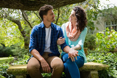 Romantic couple interacting with each other in garden. On a sunny day Stock Images