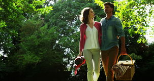 Romantic couple interacting while walking in park. During summer stock footage