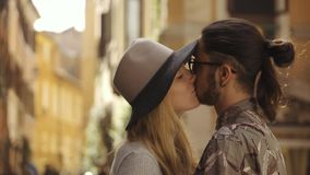 Romantic couple kisses on the old streets of Rome stock footage