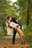 Romantic couple kissing. In autumn park Royalty Free Stock Images