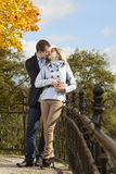 Romantic couple kissing in autumn park Royalty Free Stock Images
