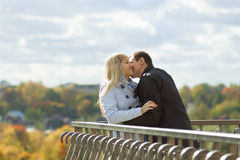 Romantic couple kissing in autumn park Stock Photo
