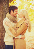 Romantic couple kissing in the autumn park Royalty Free Stock Photo
