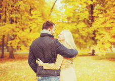 Romantic couple kissing in the autumn park Royalty Free Stock Images