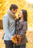 Romantic couple kissing in the autumn park Royalty Free Stock Image