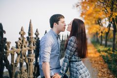 Romantic couple kissing in autumn park Royalty Free Stock Photography