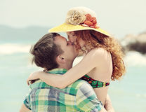Romantic couple kissing on the beach. Stock Image