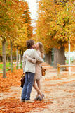 Romantic couple kissing on a beautiful fall day Stock Photo
