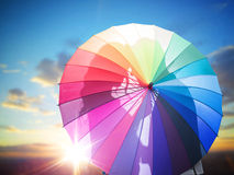Romantic couple kissing behind the umbrella. Romantic couple kissing behind the colorful umbrella Stock Photography