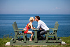 Romantic couple sitting on the bench Stock Images
