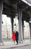 Romantic couple kissing on the Bir-Hakeim bridge Stock Photos