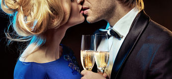 Romantic couple kissing and drinking champagne. Elegant couple kissing and drinking champagne Stock Photo