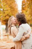 Romantic couple kissing on a fall day Stock Photography