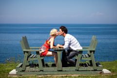 Romantic couple sitting on the bench Royalty Free Stock Image