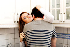 Romantic couple kissing in the kitchen. Royalty Free Stock Photography