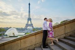 Romantic couple kissing near the Eiffel tower in Paris, France Stock Image