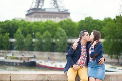 Romantic couple kissing near the Eiffel tower Royalty Free Stock Photo