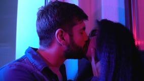 Romantic couple kissing in night illumination, love feelings, feeling tenderness