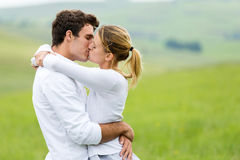 Romantic couple kissing stock photography