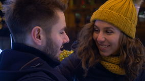 Romantic couple kissing outside in a cold dark night stock video footage
