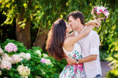 Romantic couple kissing in the summer park Royalty Free Stock Images
