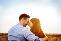 Romantic couple kissing during sunset Royalty Free Stock Images