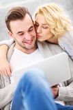 Romantic couple with laptop in living room Royalty Free Stock Photo