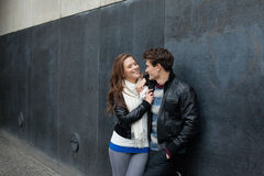Romantic Couple Leaning On Wall Royalty Free Stock Photography