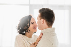 Romantic couple in light room staring at each other's eyes Stock Photo