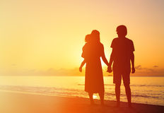 Romantic couple with little child at sunset Royalty Free Stock Images