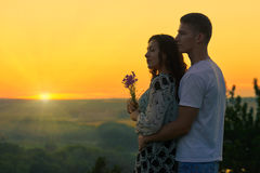 Romantic couple look on sun, evening on outdoor, beautiful lands Royalty Free Stock Images