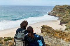 Romantic couple looking at beautiful beach Stock Photos