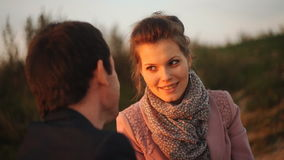 Romantic couple looking at each other on background of sunset stock video footage