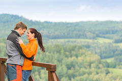 Smiling couple hugging outdoors nature background Royalty Free Stock Image