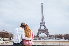 Romantic couple looking at Eiffel tower in Paris stock photo