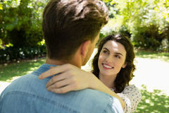 Romantic couple looking face to face in garden. On a sunny day Stock Image