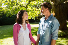 Romantic couple looking face to face in garden Stock Photos