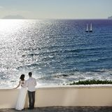 Romantic couple looking at the sea in wedding day in Italy Royalty Free Stock Image