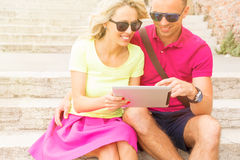 Romantic couple looking at tablet computer Royalty Free Stock Image