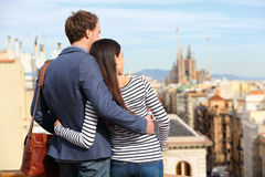 Romantic couple looking at view of Barcelona. Happy lovers enjoying cityscape with famous landmarks. Stylish urban young men and women on travel in Catalonia Royalty Free Stock Photos
