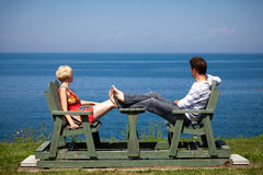 Romantic couple sitting on the bench Royalty Free Stock Images