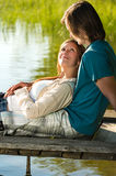 Romantic couple lounging on the pier Royalty Free Stock Images