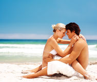Romantic couple in love at the beach Stock Image