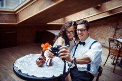 Romantic couple in love bonding in cafe. Happy romantic couple in love bonding in cafe Stock Images