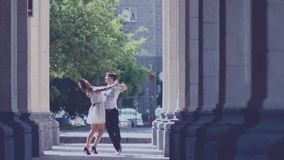 Romantic couple in love dancing in the street.