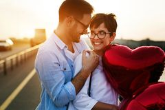Romantic couple in love dating in sunset outdoor Royalty Free Stock Image