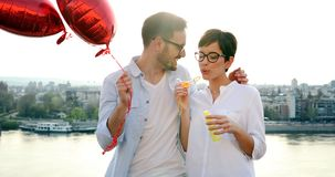 Romantic couple in love dating in sunset outdoor. Romantic couple in love dating and smiling in sunset outdoor Stock Photography