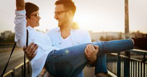 Romantic couple in love dating in sunset outdoor. Romantic couple in love dating and smiling in sunset outdoor Royalty Free Stock Photo
