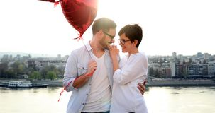 Romantic couple in love dating in sunset outdoor. Romantic couple in love dating and smiling in sunset outdoor Royalty Free Stock Photography